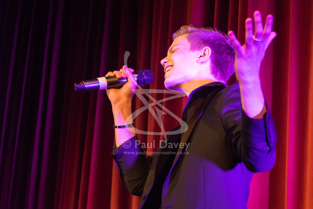Old Town Hall, Stratford, London - 28 November 2015. Singers Marc Almond, Ronan Parke, Heather Peace and Asifa Lahore headline the Peter Tatchell Foundation's inaugural Equality Ball, a fundraiser for the foundation's LGBTI and human rights work, with guest of honour Sir Ian McKellen  joined by Paul O'Grady, Rupert Everett and Michael Cashman. PICTURED: Britain's Got Talent Runner-up from 2011 when he was 12 years old, Ronan Parke performs for the guests.  //// FOR LICENCING CONTACT: paul@pauldaveycreative.co.uk TEL:+44 (0) 7966 016 296 or +44 (0) 20 8969 6875. ©2015 Paul R Davey. All rights reserved.