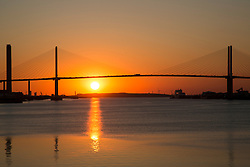 © Licensed to London News Pictures. 18/07/2016. After a baking hot day across the country, the sun sets behind the QEII Bridge across the Thames between Kent and Essex as seen from Greenhithe.  Credit : Rob Powell/LNP