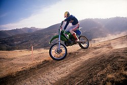 An unidentified dirt biker catches some air riding one of the trails at the Carnegie State Vehicular Recreation Area in Tracy, Calif., Thursday, Dec. 6, 1990. (D. Ross Cameron/Tri-Valley Herald)