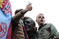West ham fans chanting on the Bobby Moore Statue outside Boleyn Ground before k/o. scenes around the Boleyn Ground, Upton Park in East London as West Ham United play their last ever game at the famous ground before their move to the Olympic Stadium next season. Barclays Premier league match, West Ham Utd v Man Utd at the Boleyn Ground in London on Tuesday 10th May 2016.<br /> pic by John Patrick Fletcher, Andrew Orchard sports photography.