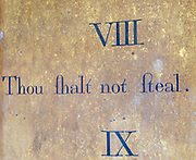 Historic interior of Saint John the Baptist church, Mildenhall, Wiltshire, England, UK 'Thou shalt not steal' commandment