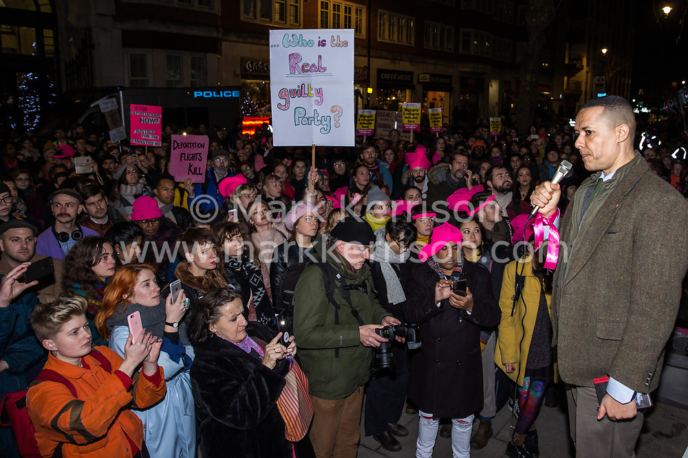 London, UK. 11th December, 2018. Clive Lewis, Shadow Treasury Minister for Sustainable Economics, addresses protesters gathered outside the Home Office to protest against the conviction using an anti-terrorism offence under the Aviation and Maritime Security Act 1990 of the Stansted 15 following non-violent direct action to try to prevent a Home Office deportation flight carrying immigrants to Nigeria, Ghana and Sierra Leone from taking off from Stansted airport in March 2017. The judge directed the jury to disregard evidence put forward in their defence that their acts were intended to stop human rights abuses.