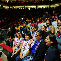 031414  Adron Gardner/Independent<br /> <br /> Members of the 1989 championship winning Shiprock lady Chieftains pose for photos during half time of the 2014 girls 3A championship game between the lady Chieftains and the Portales Rams  at The Pit in Albuquerque Friday.