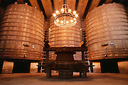 Huge oak fermenting tanks at R. Lopez Heredia winery in Haro. (Located in the railway district on the edge of Haro.)  La Rioja, Spain.