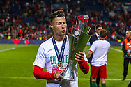 Portugal forward Cristiano Ronaldo (7) kisses the trophy after Portugal won the UEFA Nations League match between Portugal and Netherlands at Estadio do Dragao, Porto, Portugal on 9 June 2019.