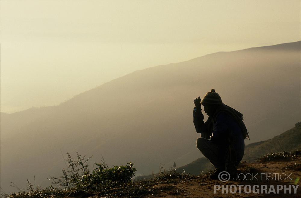 KATHMANDU, NEPAL - A sherpa rests on a ridge as the sun rises over the Kathmandu Valley. (Photo © Jock Fistick)