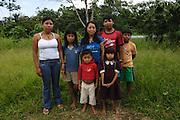 Ecuador, May 6 2010: Huaorani children pose for the camera. Copyright 2010 Peter Horrell