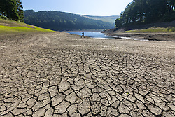 July 5, 2018 - Upper Derwent Valley, Derbyshire, UK - Scenes this morning at Derwent Reservoir in Derbyshire showing the extent that the water level has dropped during the UK heatwave leaving a sun-scorched shoreline. (Credit Image: © Andrew Mccaren/London News Pictures via ZUMA Wire)
