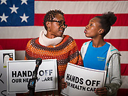 """31 OCTOBER 2019 - DES MOINES, IOWA: ROCHEAN WILDEN, left, looks at her daughter, DESHAAN WILDEN, 13, while talking about her need for affordable, comprehensive healthcare. Wilden said her daughter is autistic and they would lose their healthcare if a plan proposed by Republicans in the US Senate to eliminate coverage for pre-existing conditions passed. A small crowd of people came to the Neil Smith Federal Building, where US Senators Chuck Grassley's (R-IA) and Joni Ernst's (R-IA) offices are, to deliver a petition protesting the Senate's vote that critics say would allow """"spooky junk health insurance plans"""" with limited coverage and would allow insurance companies to deny coverage to people with pre-existing conditions.             PHOTO BY JACK KURTZ"""