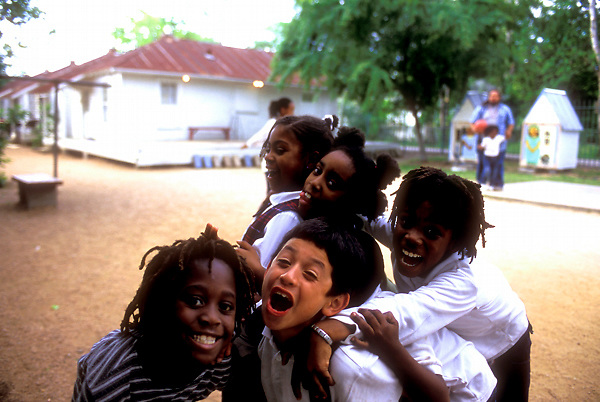 Stock photo of a group of young children playing outside at the Project Row houses