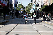 A pair of roller bladders take advantage of the deserted streets of the city on the first day of a five day snap lockdown in Victoria due to COVID-19 outbreak originating at The Holiday Inn. The entire state is returning to harsh stage-four lockdowns until Wednesday at 11.59pm as health authorities struggle to contain the Holiday Inn coronavirus outbreak.