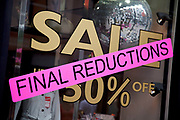 Bond Street shop sale sign offering final reductions, central London