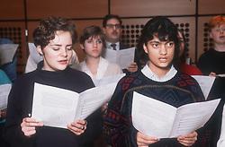 Group of people singing in choir,