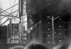 Jerry Garcia performing with The Grateful Dead. In Concert at Dillon Stadium on 31 July 1974. During the first set or beginning of the second set. This is close to full frame of the film showing the famous Budman McIntosh 2300 Amplifier. Photograph shot with a Nikon FTn Camera and Kodak Tri-X B&W Film.