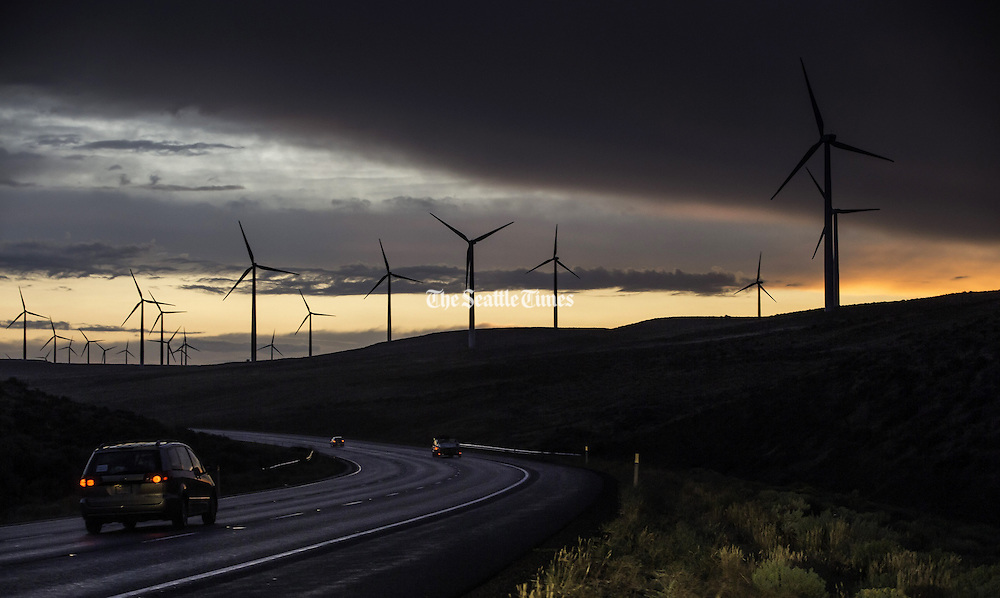Windmills that dot the landscape above Vantage, west of the Columbia River and along I-90, stand starkly against a rainstorm as it blows through Central Washington. (Dean Rutz / The Seattle Times)