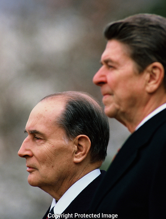 Presiden Reagan and French President  François Mitterrand during an arrival cermony on the South Lawn of the White House in March 1984<br />Photo by Dennis Brack. bb77