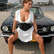 NLD/Amsterdam/20070610 - Presentatie Playboy's Playmates Collectors Special Edition, playmate en model Olga Urashova met de auto van Frans van Zoest, Spike