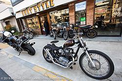 Harley-Davidson's design team member Dais Nagao on a visit to Go Takamine's Brat Style shop. Tokyo, Japan. Monday, December 8, 2014. Photograph ©2014 Michael Lichter.