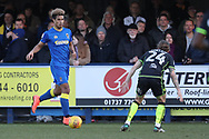 AFC Wimbledon striker Lyle Taylor (33) taking on Bristol Rovers midfielder Stuart Sinclair (24)  during the EFL Sky Bet League 1 match between AFC Wimbledon and Bristol Rovers at the Cherry Red Records Stadium, Kingston, England on 17 February 2018. Picture by Matthew Redman.