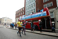 Parkinson's UK members cheer on runners during the 2018 London Landmarks Half Marathon.