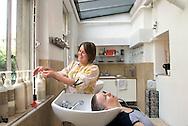 UK. London. Jarrolds Hairdressing Salon in Old Street, London. Trainee Cloe, gets on the spot training..Photo©Steve Forrest/Workers Photos