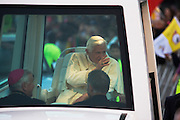 Pope Benedict XVI arrives in his Popemobile greeted by crowds in Hyde Park during his papal tour of Britain 2010, the first visit by a pontiff since 1982. Taxpayers footed the £10m bill for non-religious elements, which largely angered a nation still reeling from the financial crisis. Pope Benedict XVI is the head of the biggest Christian denomination in the world, some one billion Roman Catholics, or one in six people. In Britain there are about five million Catholics but only a quarter of Catholics regularly attend Sunday Mass and some churches have closed owing to spending cuts.