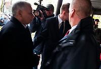 Lapy, woj. podlaskie, 26.10.2010. Spotkanie prezesa<br />  PiS Jaroslawa Kaczynskiego z mieszkancami Lap w ramach kampanii wyborczej do samorzadow. Prezesa PiS ochraniaja byli komandosi pracujacy w firmie ochroniarskiej Grom Group, ktorzy nie odstepuja go na krok. N/z Jaroslaw Kaczynski ( L ) wchodzi na spotkanie fot Michal Kosc / AGENCJA WSCHOD