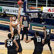 February 13 2021 Berkeley, CA  U.S.A. California guard Matt Bradley (20) drives to the hoop in the second half during the NCAA Men's Basketball game between Colorado Buffaloes and the California Golden Bears 71-62 win at Hass Pavilion Berkeley Calif.  Thurman James / CSM