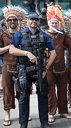 © Licensed to London News Pictures. 27/05/2017. London, UK. Exeter Chiefs rugby fans pose for pictures with armed police outside Twickenham stadium ahead of the Aviva Premiership Rugby Final. Security has been increased at venues across the UK, with the military called in to help police, following a terrorist attack at a music concert in Manchester on Monday evening. Photo credit: Peter Macdiarmid/LNP