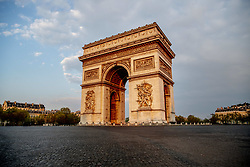 A view of the deserted Arc de Triomphe (Arch of Triumph) on the Place Charles de Gaulle Etoile in Paris, France on April 12, 2020. France's overall death toll from the coronavirus has risen to nearly 14,400 - but for the fourth day in a row, slightly fewer people were admitted into intensive care.The French president is expected to announce the lengthening of a country-wide lockdown which began on March 17 and were renewed two weeks later. Photo by Robin Utrecht/ABACAPRESS.COM