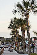 People look out at Matanzas Bay from the promenade along Avenida Menendez in St. Augustine, Florida. St Augustine is the oldest city in America.