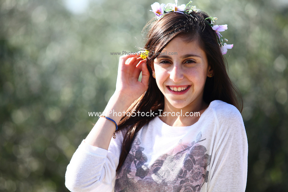 Young twelve year old preteen girl outdoors enjoys nature (model release available)