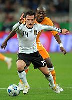 Fotball<br /> Tyskland v Elfenbenskysten<br /> Foto: Witters/Digitalsport<br /> NORWAY ONLY<br /> <br /> 18.11.2009<br /> <br /> v.l. Piotr Trochowski Deutschland, Guy Demel<br /> Fussball Testspiel Deutschland - Elfenbeinkueste 2:2