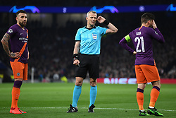 09.04.2019, White Hart Lane, London, ENG, UEFA CL, Tottenham Hotspur vs Manchester City, Viertelfinale, Hinspiel, im Bild Referee Bjorn Kuipers listens in to his VAR colleagues as Nicolás Otamendi and David Silva of Manchester City look on // Referee Bjorn Kuipers listens in to his VAR colleagues as Nicolás Otamendi and David Silva of Manchester City look on during the UEFA Champions League quarterfinals, 1st leg match between Tottenham Hotspur and Manchester City at the White Hart Lane in London, England on 2019/04/09. EXPA Pictures © 2019, PhotoCredit: EXPA/ Focus Images/ Martyn Haworth<br /> <br /> *****ATTENTION - for AUT, GER, FRA, ITA, SUI, POL, CRO, SLO only*****