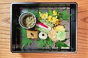 Assortment of seasonal vegetables (awa-fu, daitokuji-nattou, pearl onion, enoki mushrooms, sansho pepper, corn, mistuba, morning radish, lotus root, tofu-yo, kaede-fu, asparagus, zucchini and umeboshi) at Kajitsu, 125 E. 39th St., New York.