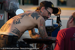 Team Vino mechanics Chrys Miranda and Big Swede work on Dean's bike. Motorcycle Cannonball coast to coast vintage run. Stage 5 (229 miles) from Bowling Green, OH to Bourbonnais, IL. Wednesday September 12, 2018. Photography ©2018 Michael Lichter.