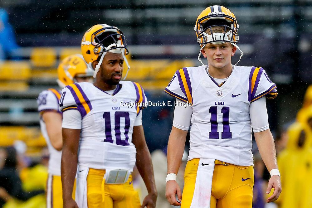 Sep 21, 2013; Baton Rouge, LA, USA; LSU Tigers quarterback Hayden Rettig (11) and quarterback Anthony Jennings (10) before a game against the Auburn Tigers at Tiger Stadium. Mandatory Credit: Derick E. Hingle-USA TODAY Sports