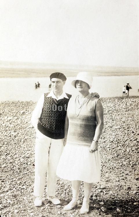 couple posing on the beach 1920s