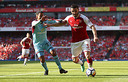 Burnley's Aaron Lennon (left) and Arsenal's Sead Kolasinac battle for the ball