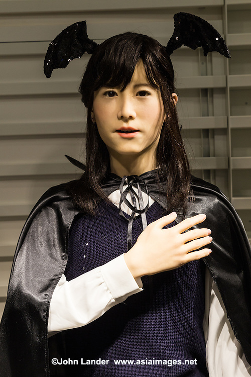 Toshiba has developed a multilingual android who greets and informs visitors to Odaiba's Aqua City in three languages. ChihiraJunco is a lifelike female robot, and she can speak Japanese, English and Chinese.  ChihiraJunco gives presentations about herself and introduces events taking place in Odaiba and Aqua City.  In this image, she is introducing the Tokyo Halloween event, taking place in Odaiba this week.   ChihiraJunco is the younger sister of ChihiraAico, another android that was also developed by Toshiba.  Junco is able to speak Chinese, unlike her sister Aico.  Also, her gestures and body movements are more smooth and lifelike.