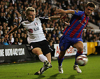 Fulham FC vs FC Basel UEFA Europa League 01/10/09<br /> Photo Nicky Hayes Fotosports International<br /> Fulham's Bjorn Helga Riise battles with Valentin Stocker of Basle.