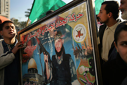 Relatives hold a martyr poster of Mohammed Zuheir Al Azzizi, Gaza, Palestinian Territories, Feb. 7, 2005. The Israeli military delivered the bodies of 15 dead militants to the Palestinians for burial. A handover celebrated in Gaza as the first real achievement of leader Mahmoud Abbas, also known as Abu Mazen, who is trying to prevent militants from straying from a fragile truce.