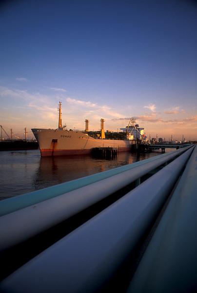 Oil tanker docked in the Port of Houston at sunset.