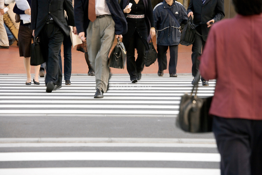 business people walking on pedestrian crossings near Tokyo Station Marunouchi district