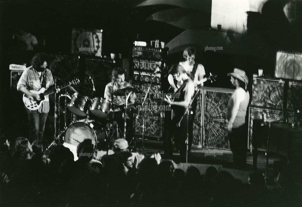 """The Grateful Dead in Concert at Yale Bowl New Haven CT on July 31, 1971. Ronald C. """"Pigpen"""" McKernan on Stage facing the rest of the Band. Also Seen in this Photograph: Jerry Garcia, Bob Weir, Phil Lesh and Bill Kreutzmann. Identity of Photographer Unknown. Negative in the Anderson Photography Archives since approx 1973"""