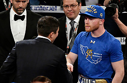 May 6, 2017. Las Vegas NV. (L-R) Gennady Gennadyevich Golovkin (GGG ) walks into the ring to meet  Canelo Alvarez after he beat Cesar Chavez Jr.Saturday at T-Mobile. Golden Boy Promotions made the official announcement of the long awaited  fight between GGG and Canelo Alvarez. The    fight will happen in September with location till unknown. .Photo by Gene Blevins/LA DailyNews/SCNG/ZUMAPRESS (Credit Image: © Gene Blevins via ZUMA Wire)