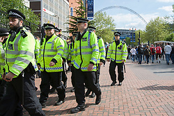 © licensed to London News Pictures. London, UK 25/05/2013. Police officers patrolling around Webley Stadium after clashes between Borussia Dortmund and Bayern Munich fans reported ahead of Champions League final in London. Photo credit: Tolga Akmen/LNP