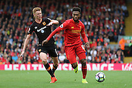 Daniel Sturridge of Liverpool gets away from Sam Clucas of Hull City. Premier League match, Liverpool v Hull City at the Anfield stadium in Liverpool, Merseyside on Saturday 24th September 2016.<br /> pic by Chris Stading, Andrew Orchard sports photography.