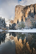 El Capitan and the Merced River during an Autumn snow storm in Yosemite National Park, California