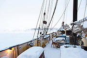 On deck of the Noorderlicht, a Dutch Schooner. Each year the Nooderlicht is frozen into the ice in Spitsbergen, and serves as an excellent base camp in the wilderness, perfect for spotting polar bears. Spitsbergen is the largest island of the arctic archipelago Svalbard, of Norway